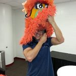 Jon Finkel putting on the Miami Heat mascot costume